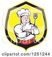 Clipart Of A Laughing Asian Male Chef Holding A Spatula In A Yellow And Black Shield Royalty Free Vector Illustration