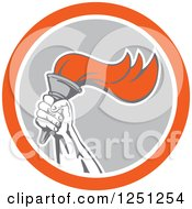 Hand Holding Up A Flaming Torch In A Gray White And Orange Circle