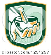 Clipart Of A Retro Hand Holding A Mortar And Pestle In A Green And Yellow Shield Royalty Free Vector Illustration