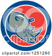 Clipart Of A Retro Rhino In A Red White And Blue Circle Royalty Free Vector Illustration by patrimonio