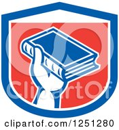 Clipart Of A Retro Hand Holding Up A Book In A Red White And Blue Shield Royalty Free Vector Illustration