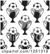 Clipart Of A Seamless Black And White Soccer Ball And Trophy Background Pattern Royalty Free Vector Illustration