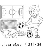 Clipart Of A Black And White Presenting Boy Soccer Player And Accessories Royalty Free Vector Illustration by visekart