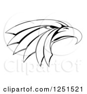 Clipart Of A Black And White Tough Eagle Head In Profile Royalty Free Vector Illustration by AtStockIllustration