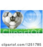 Clipart Of A 3d Heart Soccer Ball In Grass Over Sunshine Royalty Free Vector Illustration by AtStockIllustration