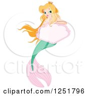 Blond Princess Mermaid With A Pink Sign