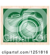 Clipart of a Sketched Camera on a Chalkboard - Royalty Free Vector Illustration by Andrei Marincas #COLLC1251816-0167