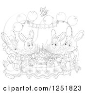 Clipart Of A Black And White Rabbit Family Having Cake On Easter Royalty Free Vector Illustration