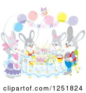 Clipart Of A Gray Rabbit Family Having Cake On Easter Royalty Free Vector Illustration