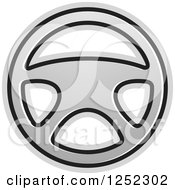 Clipart Of A Silver Steering Wheel Royalty Free Vector Illustration by Lal Perera