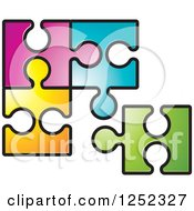 Clipart Of Colorful Jigsaw Puzzle Pieces Royalty Free Vector Illustration by Lal Perera