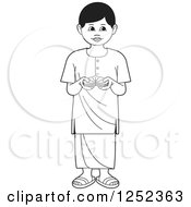 Clipart Of A Black And White Boy With Sinhala Betel Royalty Free Vector Illustration