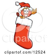 Sink Plunger Mascot Cartoon Character Wearing a Santa Hat Inside a Red Christmas Stocking