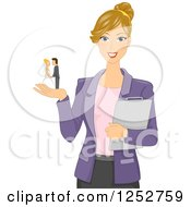 Blond White Wedding Planner Woman With A Cake Topper In Her Hand
