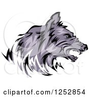 Clipart Of A Growling Wolf Head In Profile Royalty Free Vector Illustration