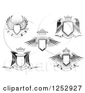 Clipart Of Black And White Winged Shields Crowns And Banners Royalty Free Vector Illustration