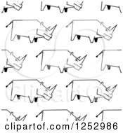 Clipart Of A Seamless Background Of Sketched Black And White Rhinos Royalty Free Vector Illustration by Seamartini Graphics
