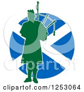 Clipart Of A Green Silhouetted Scot Piper Holding Bagpipes Over A Scottish Flag Royalty Free Vector Illustration #1253064 by Maria Bell