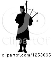 Clipart Of A Black Silhouetted Scottish Piper Holding Bagpipes Royalty Free Vector Illustration by Maria Bell