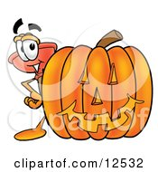 Sink Plunger Mascot Cartoon Character With A Carved Halloween Pumpkin