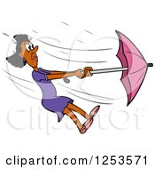 Black Woman Struggling With An Umbrella In A Wind Storm