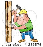 White Male Carpenter Hammering A Wood Stud