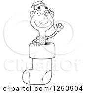 Clipart Of A Black And White Grandpa Christmas Elf Waving In A Stocking Royalty Free Vector Illustration by Cory Thoman