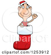 Clipart Of A Grandpa Christmas Elf Waving In A Stocking Royalty Free Vector Illustration by Cory Thoman