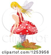 Blond Female Fairy Sitting On A Fly Agaric Mushroom