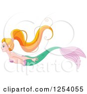 Clipart Of A Swimming Red Haired Mermaid Royalty Free Vector Illustration