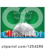 Clipart Of An Open Book And Apple With Back To School Written On A Chalk Board Royalty Free Vector Illustration