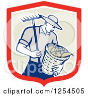 Retro Male Farmer Carrying A Harvest Bushel Bucket And Rake In A Shield
