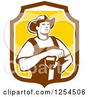 Clipart Of A Retro Male Farmer Resting An Arm On A Shovel In A Brown And Yellow Shield Royalty Free Vector Illustration by patrimonio