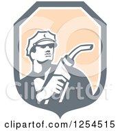 Retro Gas Station Attendant Jockey Holding A Nozzle In A Shield