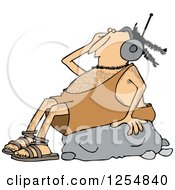 Caveman Wearing Headphones And Listeing To Music On A Rock