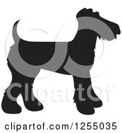 Clipart Of A Black Silhouetted Airedale Terrier Dog In Profile Royalty Free Vector Illustration