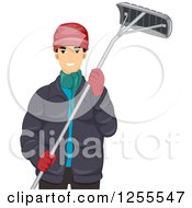 Young Man In Winter Clothes Holding A Roof Rake