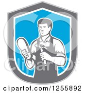 Clipart Of A Retro Male Shoemaker In A Blue Gray And White Shield Royalty Free Vector Illustration by patrimonio