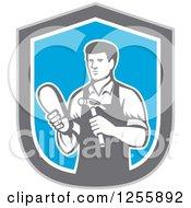 Retro Male Shoemaker In A Blue Gray And White Shield