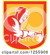 Clipart Of A Retro Welder Working In A Red Yellow And Orange Shield Royalty Free Vector Illustration