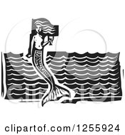 Clipart Of A Black And White Woodcut Mermaid With A Goblet Of Wine Over Waves Royalty Free Vector Illustration