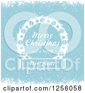 Clipart Of A Blue Winter Background With Merry Christmas And A Happy New Year Text On A Wreath Royalty Free Vector Illustration by elaineitalia