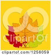 Clipart Of A Trio Of Autumn Leaves Over Yellow With Text Space Royalty Free Vector Illustration