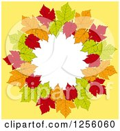 Clipart Of A Round Frame Of Autumn Leaves Over Yellow With White Text Space Royalty Free Vector Illustration
