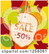 Clipart Of An Acorn Shaped Autumn Sale Fifty Percent Off Discount Tag Over Autumn Leaves Royalty Free Vector Illustration by elaineitalia