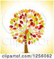 Clipart Of A Tree With Colorful Autumn Leaves Over Yellow Royalty Free Vector Illustration