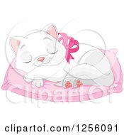 Cute White Kitten Wearing A Pink Bow And Napping On A Pillow