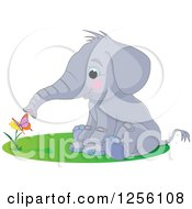 Clipart Of A Cute Baby Elephant Smelling A Butterfly On A Flower Royalty Free Vector Illustration