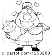 Clipart Of A Black And White Loving Mother Holding A Baby Royalty Free Vector Illustration by Cory Thoman