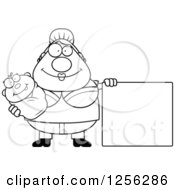 Clipart Of A Black And White Happy Mother Holding A Baby By A Blank Sign Royalty Free Vector Illustration by Cory Thoman